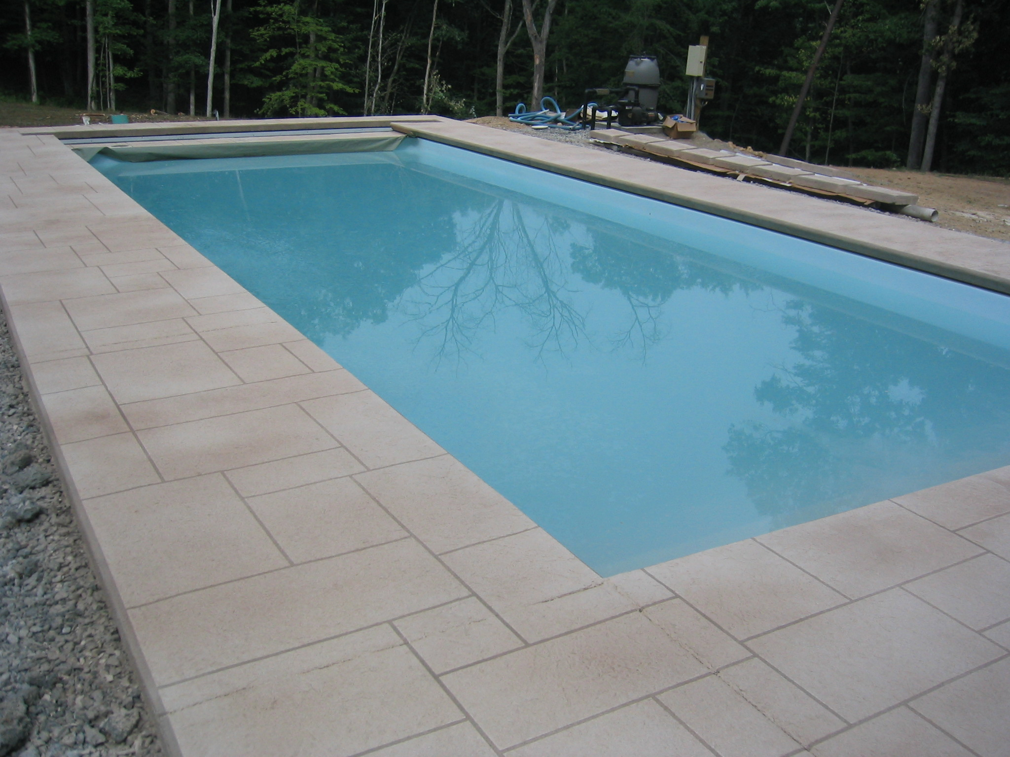 Stamped concrete pool deck blackwater concrete for Concrete pool