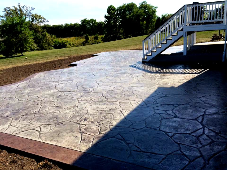 backyard face rock patio concrete tiered stairs with patios step stamped