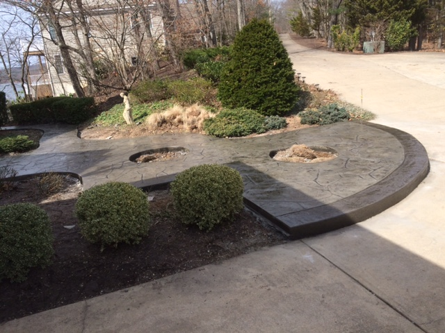 Custom Concrete Design with border and holes for planting