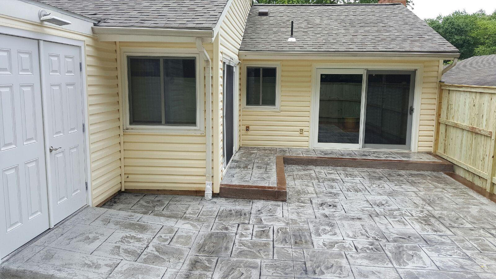 Ashlar Slate Stamped Concrete Patio Designed By Blackwater Concrete. Grey  Stamp With Tan Border.