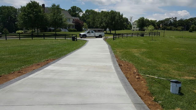 Large and Spacious Concrete Driveway in Northern Virginia, designed by the crew at Blackwater Designer Concrete.