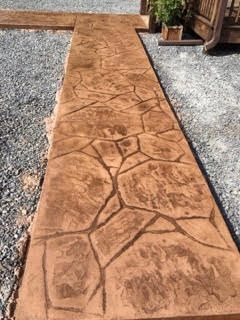 Walkway stamped with arizona flagstone pattern - Why you should consider concrete staining for your home ...